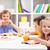 kids around the table eating stock photo © ilona75