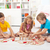 three kids playing with wooden blocks stock photo © ilona75