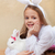 Little girl in bunny costume holdng her white rabbit stock photo © ilona75
