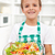 Happy boy with fresh salad - healthy nutrition stock photo © ilona75