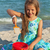 young girl playing in the sand by the sea stock photo © ilona75