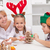 Woman and her kids decorating christmas cookies stock photo © ilona75