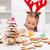 Girl decorating gingerbread cookies stock photo © ilona75