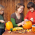 woman helping kids to carve their halloween jack o lantern stock photo © ilona75