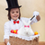 happy magician boy conjuring an easter rabbit and colorful eggs stock photo © ilona75