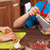 Kids preparing a pizza together - closeup on hands, shallow dept stock photo © ilona75