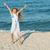 mutlu · yaz · atlamak · deniz · plaj · küçük · kız - stok fotoğraf © ilona75