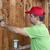 Man painting wooden wall stock photo © ilona75