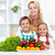 woman and kids with vegetables in the kitchen stock photo © ilona75