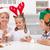 Happy people making gingerbread christmas tree stock photo © ilona75