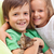 happy kids with their new pet   a little kitten stock photo © ilona75