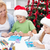 family at christmas time making greeting cards stock photo © ilona75