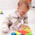 baby girl playing eith wooden blocks stock photo © ilona75