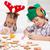 Santa little helpers decorating gingerbread cookies stock photo © ilona75