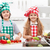 kids helping in the kitchen   washing and slicing vegetables stock photo © ilona75