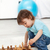 toddler boy playing with chess pieces stock photo © ilona75