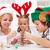 Family decorating the gingerbread christmas tree stock photo © ilona75