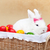 cute easter bunny sitting in basket with colorful eggs   closeup stock photo © ilona75