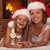Happy mother and daughter celebrating Christmas together stock photo © ilona75
