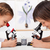 Young kids in science lab study samples under the microscope-foc stock photo © ilona75
