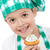 child with chef hat holding muffin stock photo © ilona75