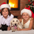 happy kids and their pets celebrating christmas stock photo © ilona75