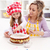 little girl making her first fruit cake with some help stock photo © ilona75