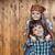 happy kids portrait against wooden wall stock photo © ilona75