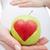 donna · mano · mela · rossa · a · forma · di · cuore · cibo · sano - foto d'archivio © ilona75