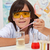 young pupil conducting a simple chemical experiment stock photo © ilona75