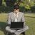 giovani · imprenditore · utilizzando · il · computer · portatile · seduta · giù · esterna - foto d'archivio © imagedb
