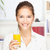 jonge · glimlachende · vrouw · glas · sinaasappelsap · home - stockfoto © imarin