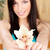 smiled woman holding white orchid stock photo © imarin
