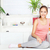 happy woman at home on sofa with fruits stock photo © imarin