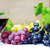 glass of red wine with grapes on a table stock photo © inaquim
