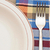 Table setting with fork, knife, plates, and colorful napkin  stock photo © inxti