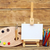 wooden easel with clean paper and artistic equipment stock photo © inxti