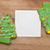 gingerbread christmas tree with blank white paper on wooden back stock photo © inxti