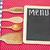 menu title written with chalk on blackboard lying on tablecloth stock photo © inxti