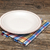 Empty plate on tablecloth on wooden table stock photo © inxti