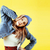 lifestyle people concept pretty young school teenage girl having fun happy smiling on yellow backgr stock photo © iordani
