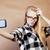 meisje · zelfportret · mobiele · telefoon · kijken · iets - stockfoto © iordani