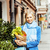 young pretty blond woman with food in bag walking on street stock photo © iordani