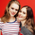 two best friends teenage girls together having fun posing emotional on red background besties happ stock photo © iordani