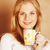 young cute blond girl drinking coffee close up on warm brown bac stock photo © iordani