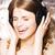 kobiet · nastolatek · śpiewu · słuchawki · uśmiechnięty · cieszyć · się - zdjęcia stock © iordani