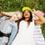 two young pretty teenager girls best friends laying on grass making selfie photo having fun lifesty stock photo © iordani