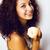 молодые · счастливым · улыбаясь · красивая · женщина · яблоко · вьющиеся · волосы - Сток-фото © iordani