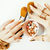 woman hands with golden manicure and many rings holding brushes makeup artist stuff stylish pure c stock photo © iordani