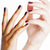 two different nathion manicured hands on white isolated african stock photo © iordani